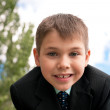 Portrait of a smiling kid outside — Stock Photo