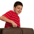 Carrying a heavy suitcase — Stock Photo