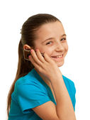 Smiling girl speaking on the mobile phone — Stock Photo