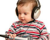 Dado a un niño habla con auriculares y micrófono — Foto de Stock