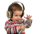 Speaking toddler with headphones and microphone — Stock Photo