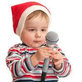 Pequeña santa con micrófono — Foto de Stock