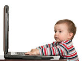 Little toddler's first studying with computer — Stock Photo