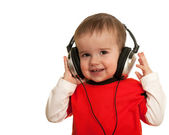 Smiling toddler with headphones — Stock Photo