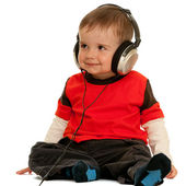 Smiling little boy with headphones — Stock Photo