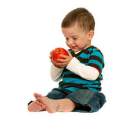 Laughing toddler holds a red apple — Stock Photo