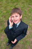Boy in suit speaking over the mobile — Stock Photo
