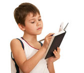 Writting thoughtful kid — Stockfoto