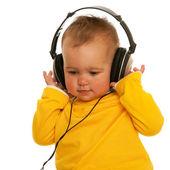 Little girl with headphones — Stock Photo