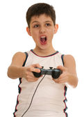 Ardor boy is playing a computer game with joystick — Stock Photo