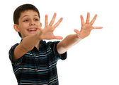 Spontaneous boy is stretching his hands towards an invisible aim — Stock Photo
