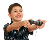 Laughing boy playing a computer game with joystick — Stock Photo