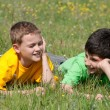 Conversation of two boys outdoors - Stock Photo