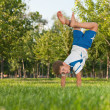 Exercises on grass in park — Stock Photo #8653417