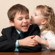 Wispering secrets in the classroom - Foto Stock