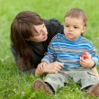Caring mother and her sonny in the park - Stock Photo