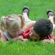 Royalty-Free Stock Photo: A boy and a little girl on the grass