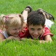 A girl and a boy  in the park — Stock Photo