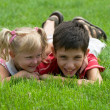 A girl and a boy  in the park — Stockfoto
