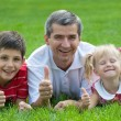 Smiling family at the park — Foto Stock