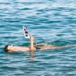Stock Photo: Mreading in sea