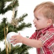 Royalty-Free Stock Photo: Little boy decorating a new year tree