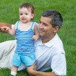 Father and his son in the park — Stock Photo