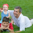 Father and his sons in the park — Stockfoto