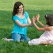 Mom and her daughter playing outside - Stock Photo
