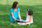Studying with mum outdoor — Stockfoto