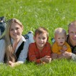 Family of four in the park — Stock Photo
