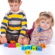 Children playing blocks — Stock Photo