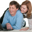 Smiling couple at the laptop — Stock Photo
