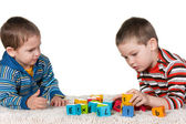 Brothers playing blocks on the carpet — Foto Stock