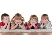 Lonely little boy at three beautiful girls — Stock Photo