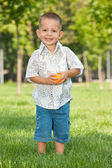 Fashion smiling little boy in the park — Stock Photo