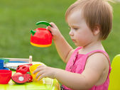 Tea party of a little girl — Stock Photo