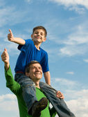 Family pointing thumbs up — Stock Photo