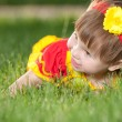 Smiling girl on the green lawn — Stock Photo