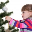 Girl decorating a new year tree — Stock Photo
