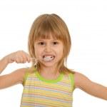 Little girl brushes her teeth — Stock Photo