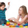 Playing on the carpet with blocks — Stock Photo #9501704