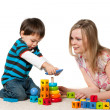Stock Photo: Playing on carpet mother and son