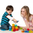 Playing on the carpet mother and son — Stock Photo