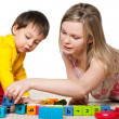 Mother and son are playing on the carpet — Stock Photo