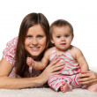 Cheerful baby girl with smiling mother — Stock Photo