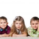 Three children on the carpet — Stock Photo #9502480