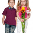 Smiling boy and pretty girl with flowers — Stock Photo #9502555