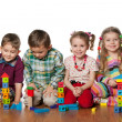 Four children are playing on the floor — Stock Photo #9502627