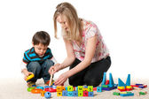 Mother and son playing on the carpet — Stock Photo